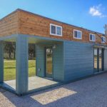 This Amazing Tiny Home With Porch Is Actually A 40-foot Shipping Container