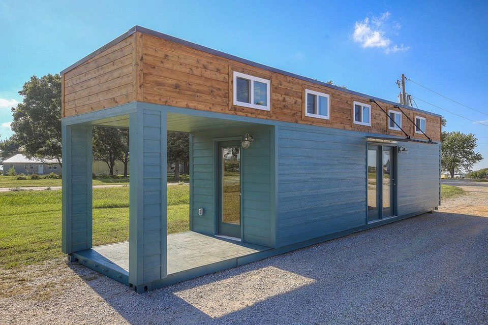 This amazing tiny home with porch is actually a 40 foot shipping container mikeshouts - Ft container home ...