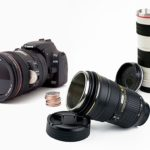 DSLR coin bank, 'Canon' and 'Nikon' lens mugs grew taller