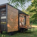 Stunning Tiny Home's Garage Door Is Also A Custom Deck And Awning