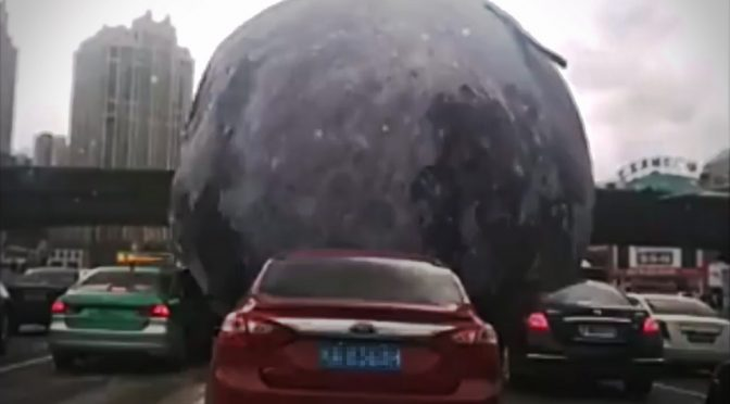 Moon Replica Rolls Thru Streets In China, 'Squashes' Everything In Its Path