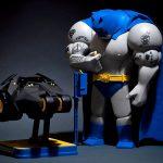 Lowfool Dressed Up As <em>Batman</em>, Ponders Over A Tumbler Kiddie Ride