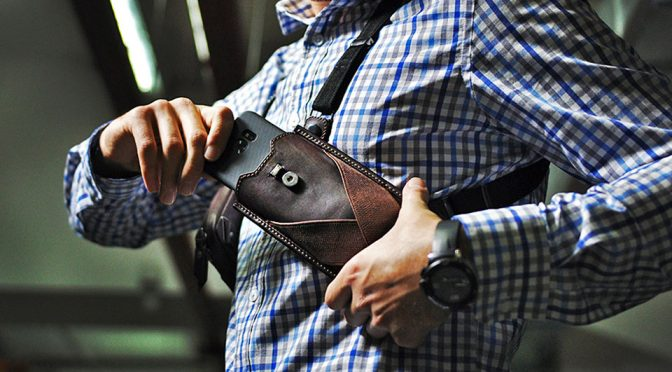 Wear Your Phone Like A Detective And Say Goodbye To Bulging Pockets