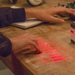 The World's Most Advanced Projection Keyboard Plays Music Too