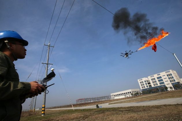 Fire-spewing Drone Burns Trash Stuck on Power Lines