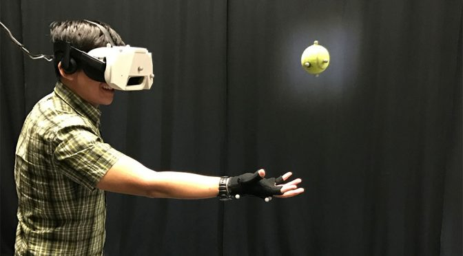 Catching a Real Ball in Virtual Reality by Disney Research