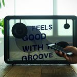 "Lyric Speaker Displays Song's Lyrics Expressively On Its 22"" Clear Display"