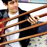 Guy Plays A Four-neck Bass Guitar With One String Per Neck Because, He Can