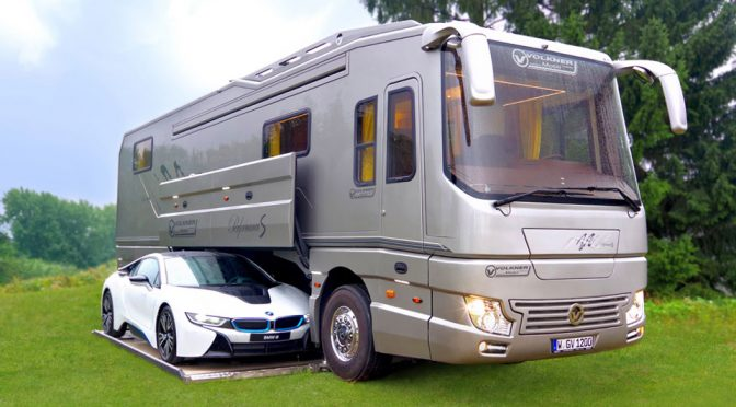 This Super Luxe Motorhome Has An Onboard Garage For A Sports Car