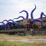 Giant Inflatable Tentacles Poking Out Of This Building Is A Sight To Behold