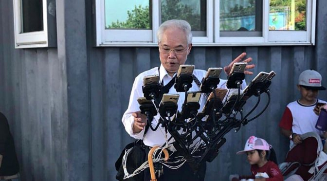 Most Dedicated <em>Pokémon Go</em> Is This Grandpa With 11 Devices
