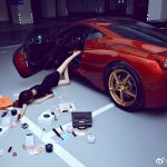 Lying On The Floor Surrounded By Luxury Goods Is The Latest Way To Flaunt Your Wealth