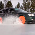 Finnish Dude Rides Over Frozen Lake In A Subaru With Saw Blade Wheels