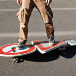 Artist Created A  Skateboard That Has A Street Signpost As Its Deck