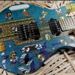10,000 Popsicle Sticks Were Used To Create This Super Accurate, Pixelated <em>Super Mario</em> Guitar