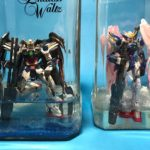 Japanese Gunpla Hobbyist Builds <em>Gundam</em> Model Inside Empty Alcohol Beverage Bottles