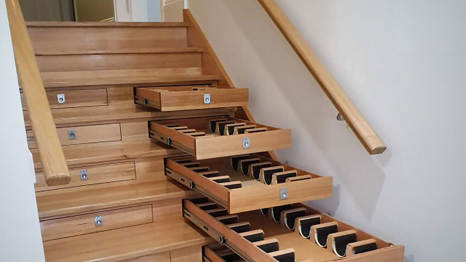 Wine Cellar Integrated into Staircase