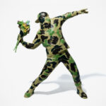 Banksy's Famous <em>Flower Bomber</em> Into A Vinyl Figure Again, This Time By BAPE