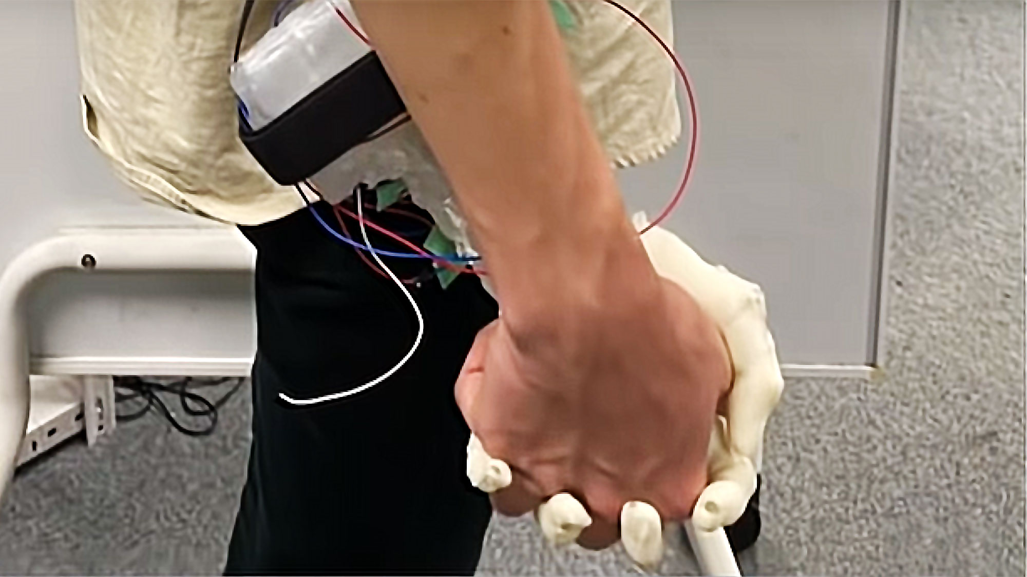 Robotic Hand Simulates Holding A Girl's Hand