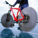 This Bicycle With Saw Blade For Wheels Lets The Rider Cycle Over A Frozen Lake