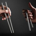 ChopChucks Is A Pair Of Collapsible Chopsticks That Is Also A Miniature Nunchuck