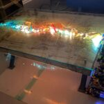 Man Created A Custom Coffee Table With LEGO Dioramas That A LEGO Waterfall Spilling Out On One Side