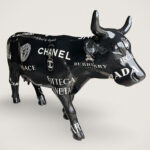 <em>Branded</em> Is Paula Crown's Fashionable Cow Sculpture Covered In Branded Fashion Labels' Logo